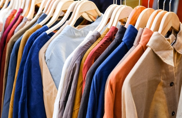 Colorful shirts on the hangers in the store