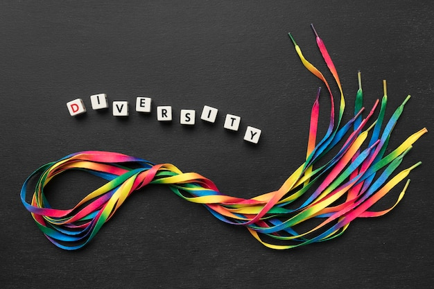 Colorful shoelaces assortment on dark background