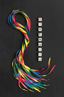 Colorful shoelaces composition on dark background