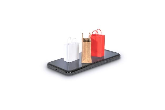 オンラインショッピングのコンセプトのための白のスマートフォンでカラフルなショッピングバッグ
