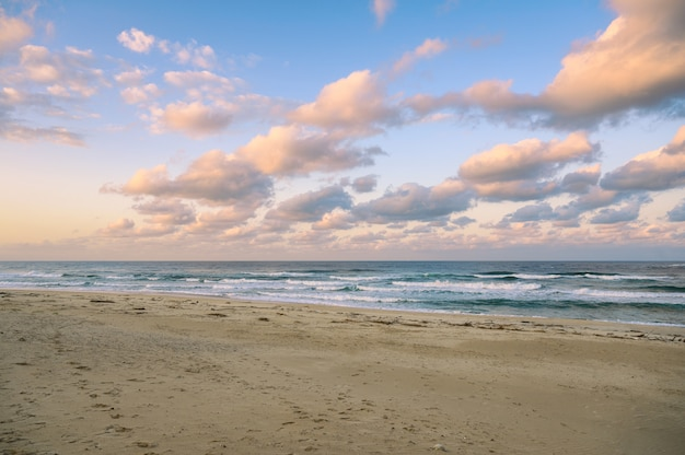 Colorful sky with clouds on the sea with beach