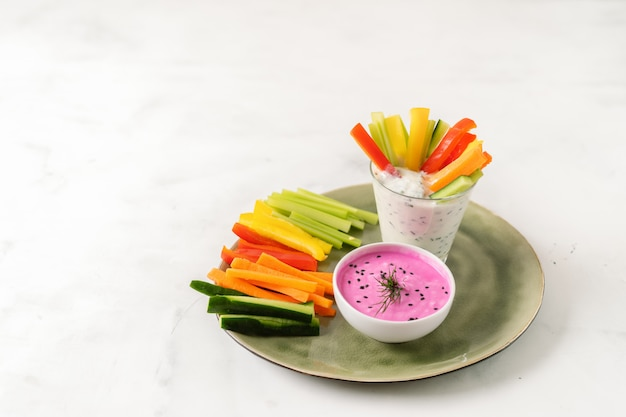 Colorful slices of raw vegetables in glass