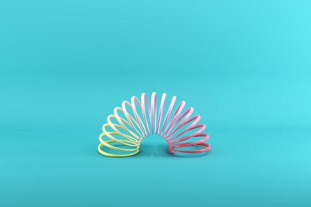 Colorful slinky on blue