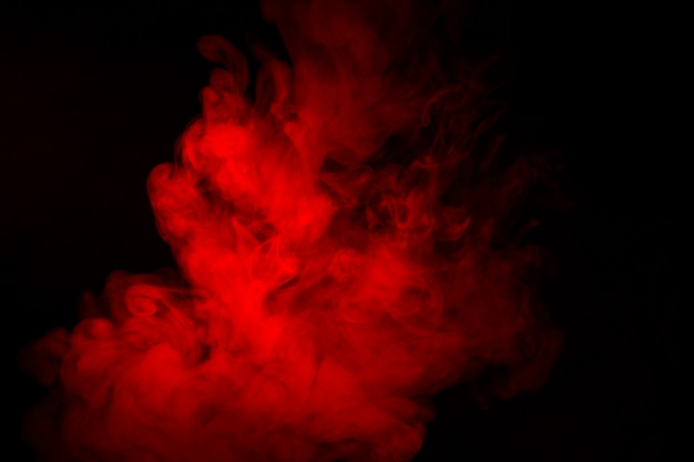 Colorful smoke close-up on a black background.