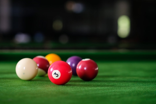 Colorful snooker balls on green frieze.