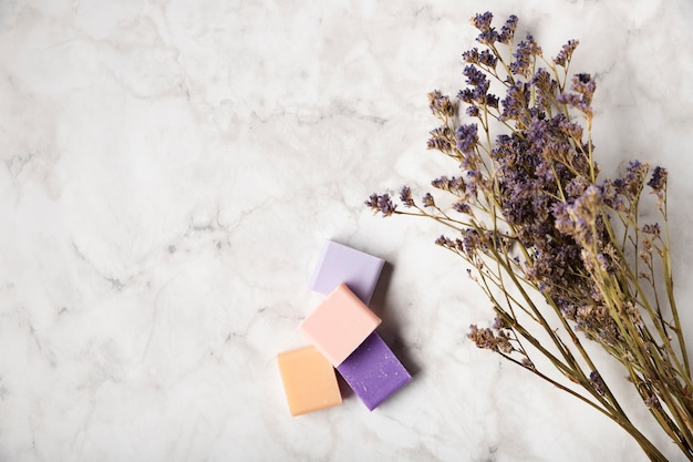 Colorful soaps next to bouquet of lavender