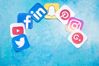 Colorful social media icons on painted blue background