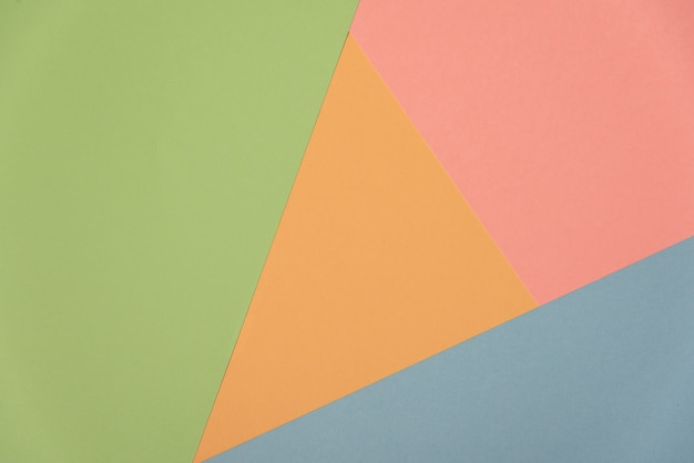 Colorful soft green, orange, cyan and pink paper background.
