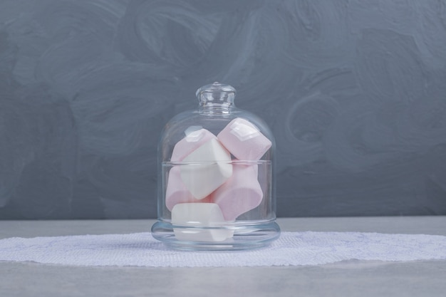 Colorful soft marshmallows in glass jar. high quality photo