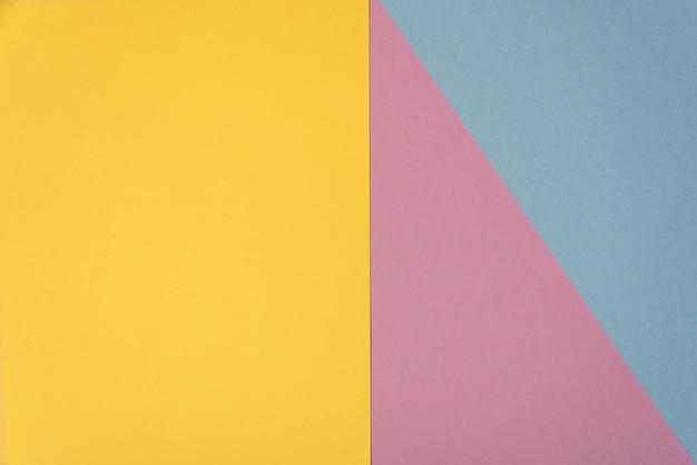 カラフルな柔らかい黄色、ライトブルー、パープルのペーパーの背景。