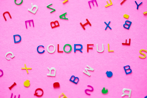 Colorful spelled word with alphabets background