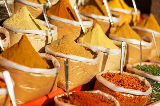 Colorful spices in bags at a market in goa