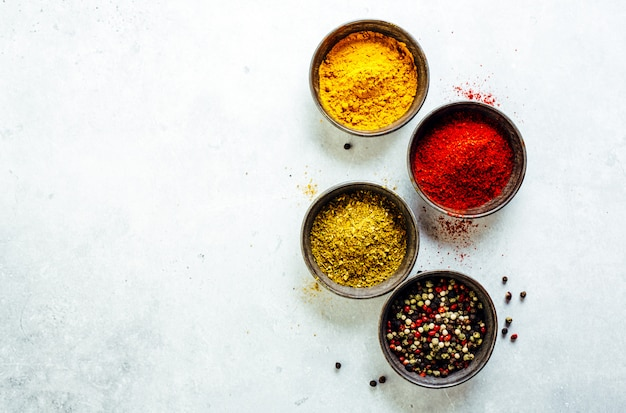 Colorful spices on bright background