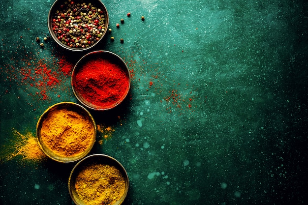Colorful spices on dark table