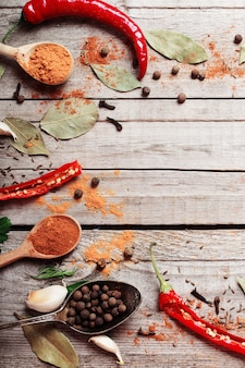 Colorful spices on a wooden surface