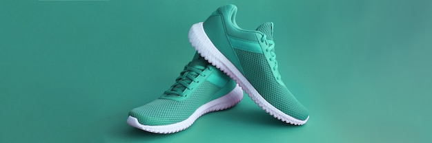 Colorful sport shoes on green color backround