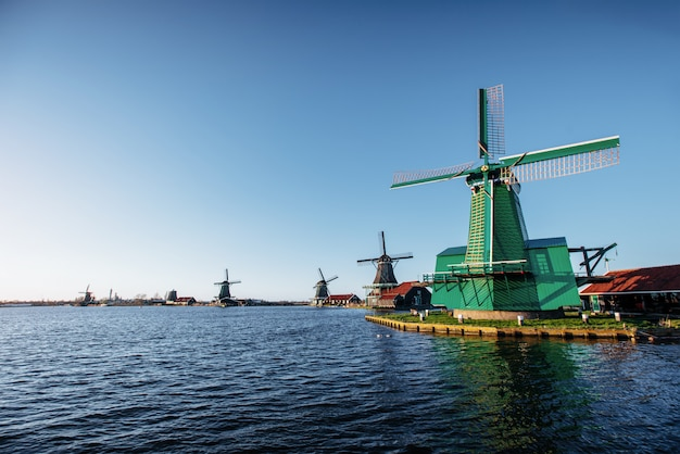 Colorful spring day with traditional dutch windmills canal in rotterdam