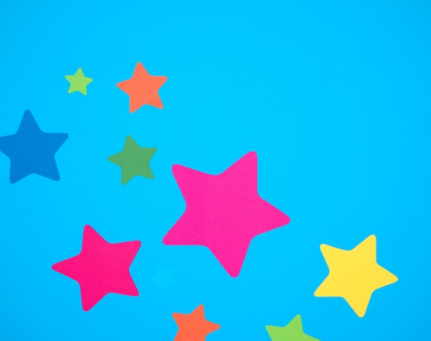 Colorful stars on blue background.