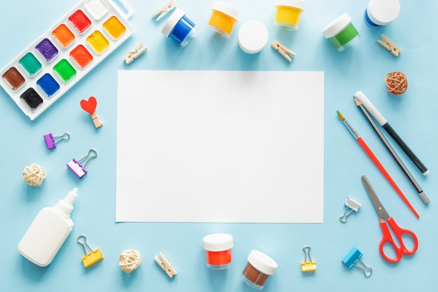 Colorful stationary school supplies on blue trending background