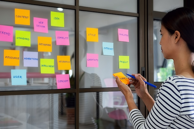 Colorful sticky notes with things to do on office board. user experience (ux) concept.