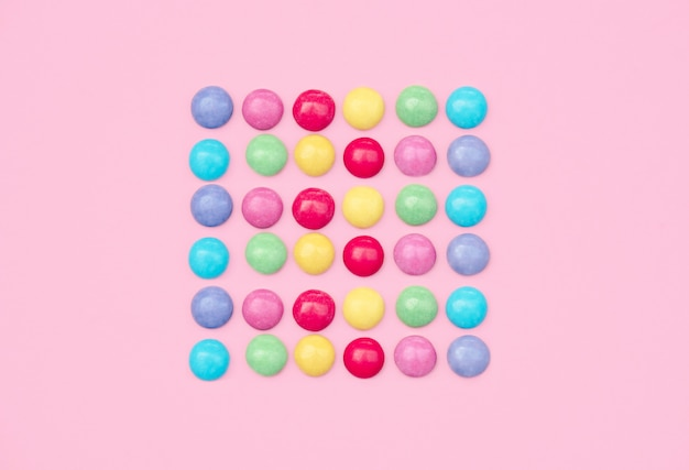 Colorful still life with sweets and present on blue background.