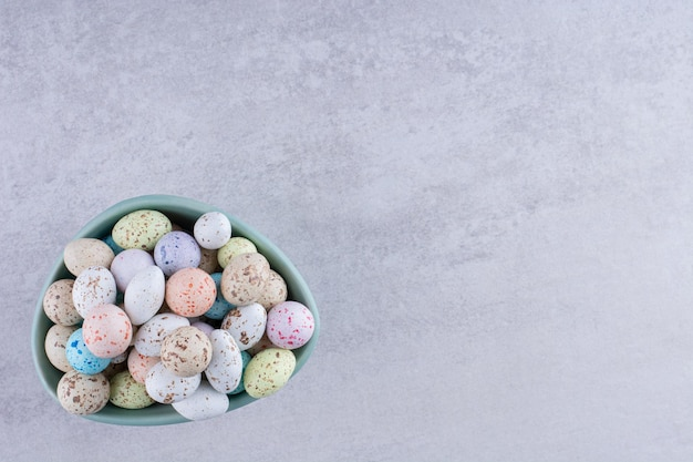 Colorful stone candies in trays on concrete background. high quality photo