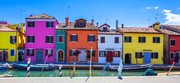 Colorful street with canal in burano, near venice, italy