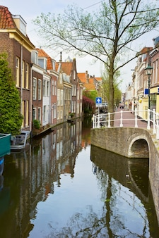 Colorful street with canals in old town  of delft, holland
