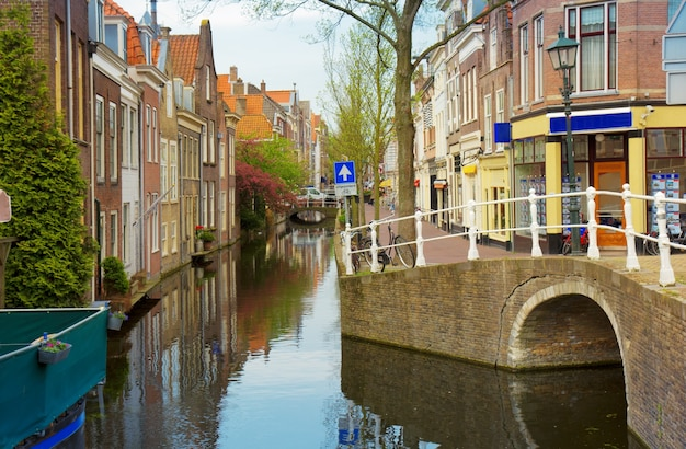 Colorful street with canals in old town  of delft, netherlands