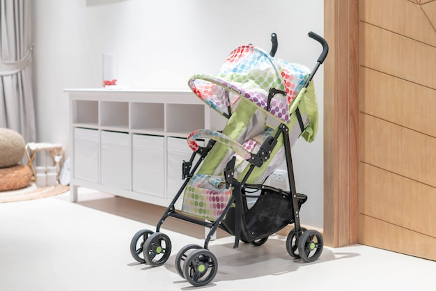 Colorful stroller in the house