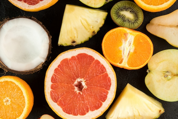 Colorful summer fruit slices composition