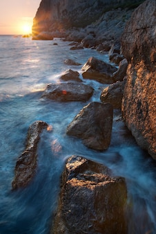 Colorful summer seascape. rocky coast at sunset