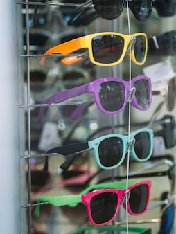 Colorful sunglasses on a stand