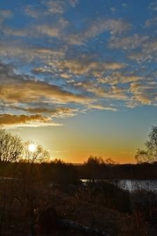 Colorful sunrise of the sun over a beautiful lake