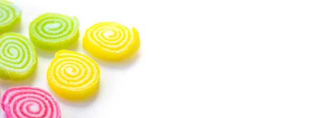 Colorful sweets and sugar candies on a white background
