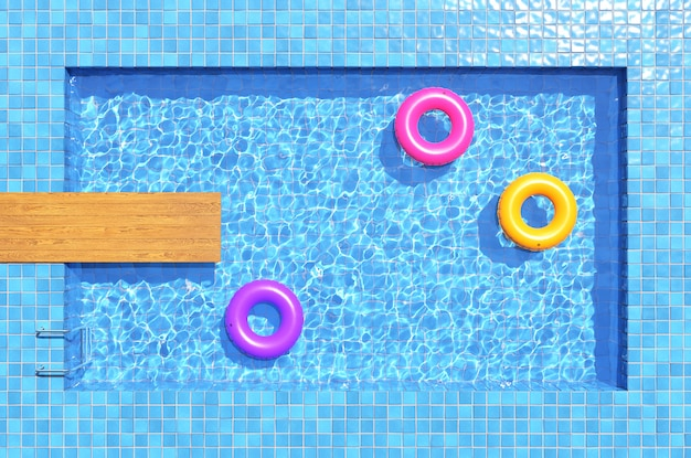 Colorful swimming rings in blue swimming pool