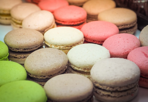 Colorful tasty macaroons in a row.