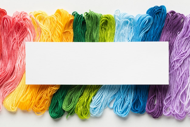 Colorful thread arrangement flat lay