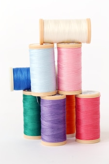 Colorful threads on a white surface