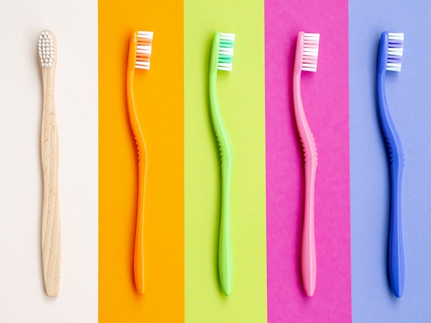 Colorful toothbrushes on colorful background