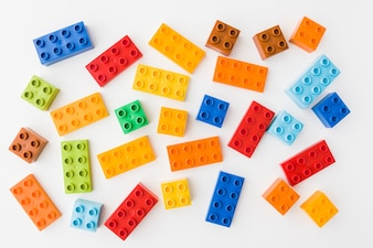 Colorful toy bricks on white background
