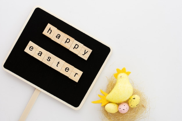 Colorful toy chicken with easter greeting