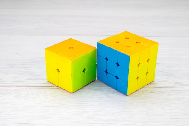 Colorful toy constructions designed shapeded on light desk, toy plastic