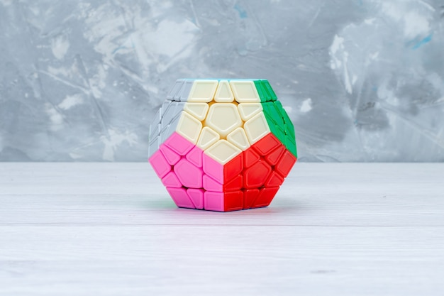Colorful toy constructions designed shapeded on white desk, toy plastic