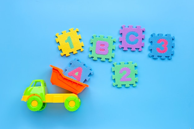 Colorful toy with english alphabet and numerals on blue background. education concept