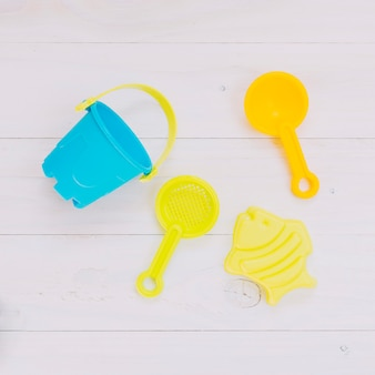Colorful toys for sandbox on light background