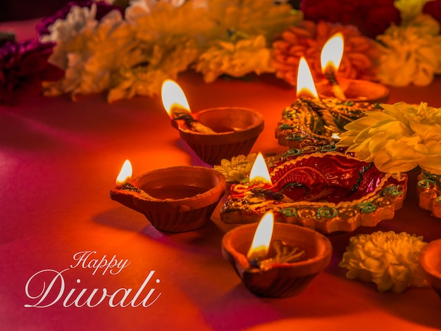 Colorful traditional clay diya lamps and flowers