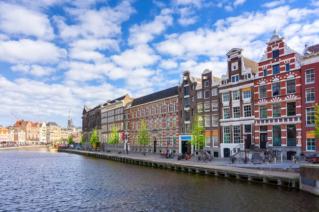 Colorful traditional old buildings in sunshine day at amsterdam, netherlands