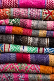 Colorful traditional peruvian fabrics on the market