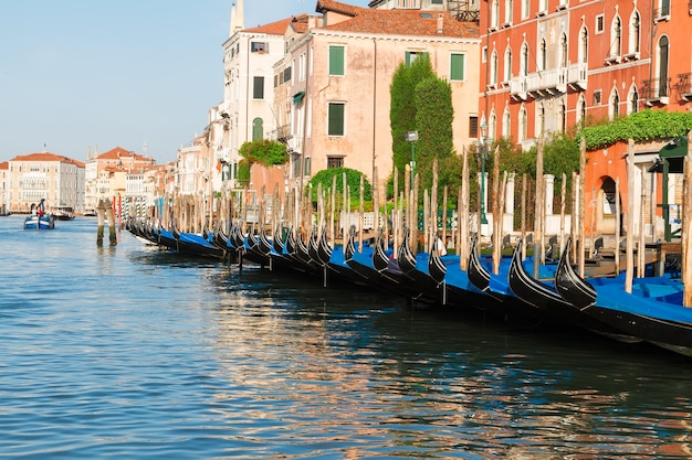 Colorful traitional venice gondola boats and houses over water of grand canal, italy